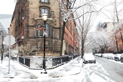 Snowy winter scene at the historic intersection of 10th and Stuyvesant Street in the East Village of Manhattan, New York City NYC