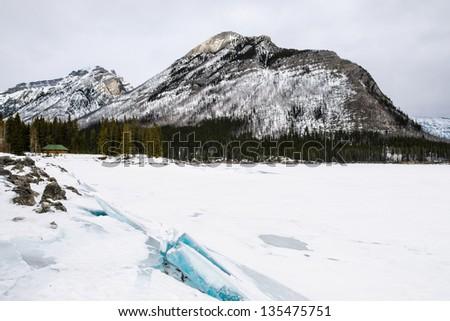 Snowy winter scenery in the Canadian Rocky Mountains - Lake Minnewanka Banff National Park, Alberta Canada