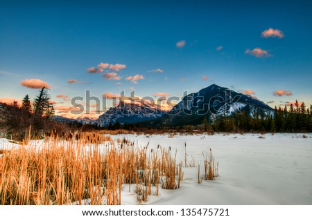 Snowy winter scenery in the Canadian Rocky Mountains - Mount Rundle and Vermillion Lakes - Banff National Park, Alberta Canada