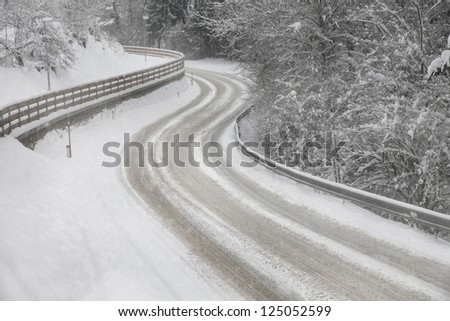 Snowy winter street road with turn.