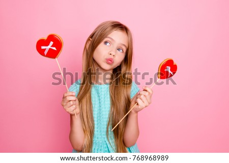 743366c8e So cute, lovely and funny! Portrait of beautiful sweet girl wearing light  blue dress · Little girl hold big lollipop against pink ...