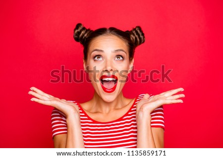 So excited and positive girl isolated on red background loud laughs raising her head and hands up. Concept of advertising, sale and discount #1135859171