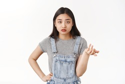 So what not care. Reluctant brunette asian girlfriend shrugging raise hand full disbelief dismay questioned look camera cannot understand why boyfriend complain stand puzzled white background