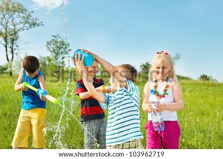 Soaked kids enjoying water time - stock photo