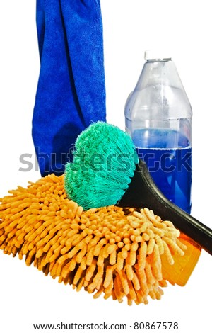 Soap, a brush,a mitt, and a towel ready to wash a car or boat.