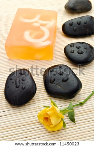 soap and spa-stones arrangement on bamboo board