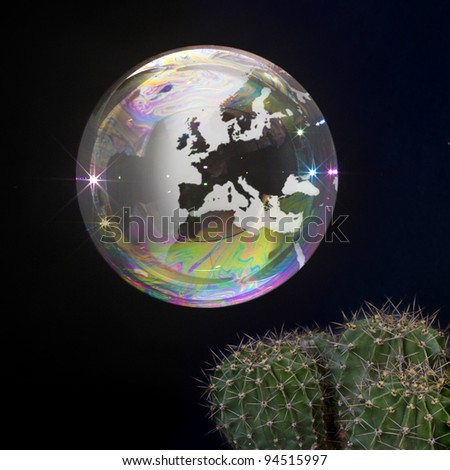 Soap bubble Earth floats close to a cactus. Fragile Earth.