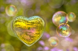 Soap bubble in the shape of a heart