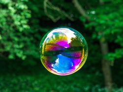 Soap bubble with the reflection of buildings inside.