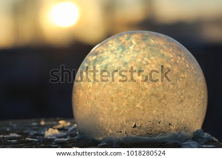 Soap bubbles freeze in the cold. Winter soapy water freezes in air. #1018280524