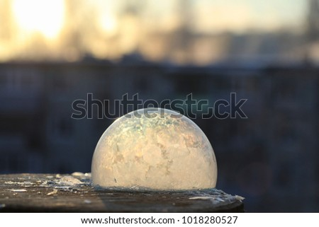 Soap bubbles freeze in the cold. Winter soapy water freezes in air. #1018280527