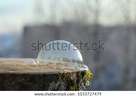 Soap bubbles freeze in the cold. Winter soapy water freezes in air. #1033727479