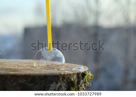 Soap bubbles freeze in the cold. Winter soapy water freezes in air. #1033727989