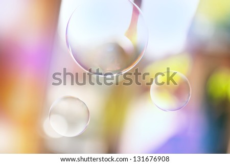 Soap bubbles on summer background