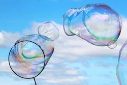 Soap bubbles, sky background funny object