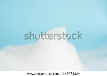 Soap foam bubble on blue background object beatuy health care concept #1167074824