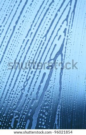 soap foam bubbles on the glass - stock photo