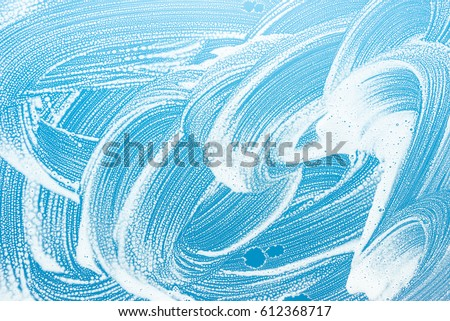 soap on a glass window background texture