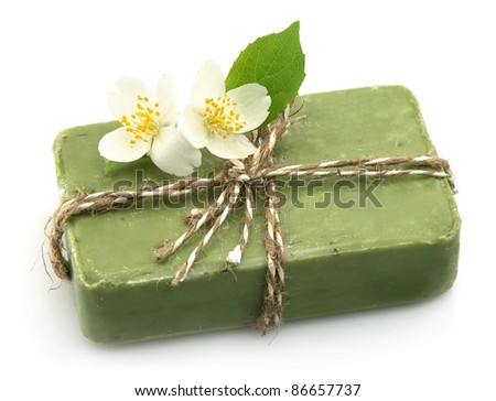 Soap with jasmine isolated on white