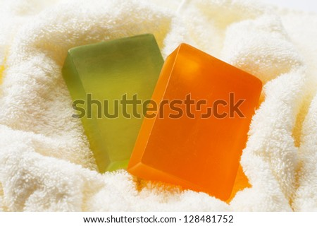 Soap wrapped in towel - stock photo