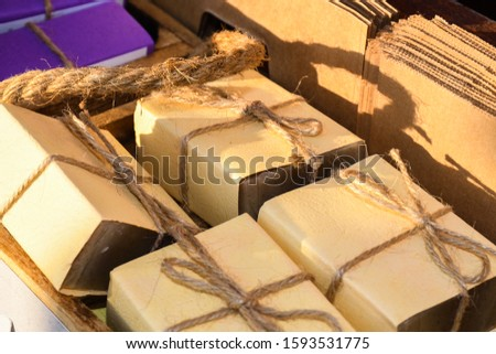 Soaps artisans, detail of soaps for body wash. Bar of natural artisan made Marseilles aromatherapy bath soap with potpourri for a pampering cleansing session in a spa