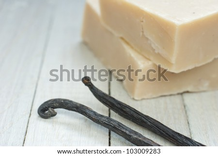 soaps with vanilla beans on bright wooden