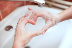 Soapy hand making heart shape. Hand hygiene. Love your hands.