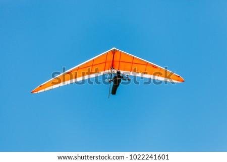Soaring hang gliding in the sky #1022241601