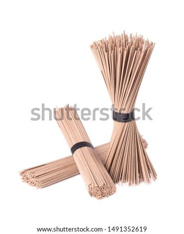 Soba noodles, isolated on white background. Bundle of buckwheat japanese soba noodle sticks. Asian food. #1491352619