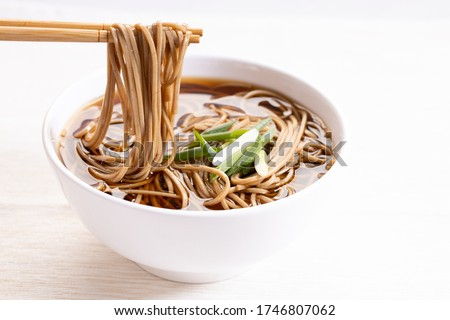 soba noodles, zaru soba, in white bowl with bamboo chopsticks Stock fotó ©