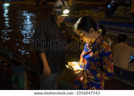 Soc Trang, Vietnam - Feb 20, 2017: Unidentified people on Nga Nam floating market in Mekong River is characteristic for the West River area casual and rustic in business agricultural commodities