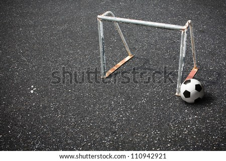 soccer ball and goal on street