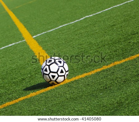 Soccer ball at the field line at stadium - stock photo