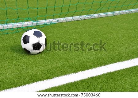 Soccer ball at the goal net