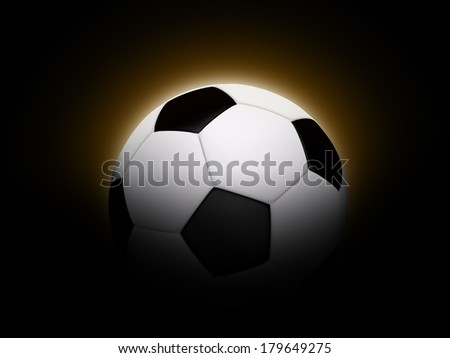 Soccer ball / football with an orange glow on a black background. Representing beginning, dawn or eclipse.
