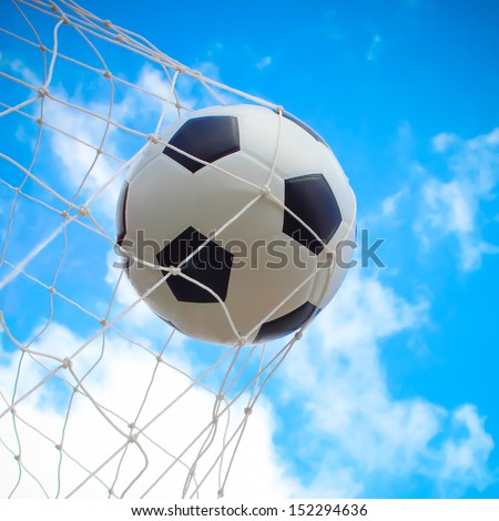 soccer ball in goal - Shutterstock ID 152294636