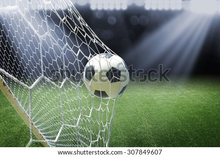 Shutterstock soccer ball in goal with spotlight