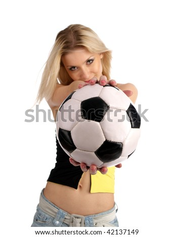 Soccer ball in the blond girl hands isolated on the white background.