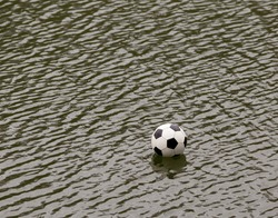 Soccer ball in the water after bad shot