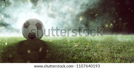 Soccer ball lays in smoke (3D Rendering)