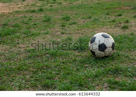 Soccer ball old on the grass  Stockfoto ©