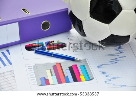 Soccer ball on a financial report
