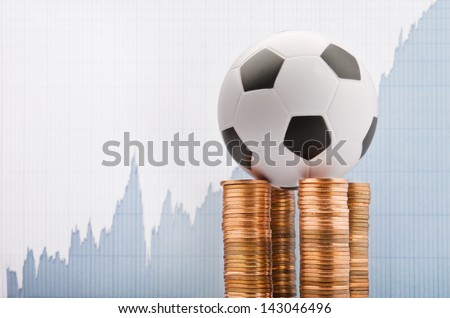 Soccer ball on a financial report background