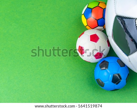 Photo of Soccer ball on a green background. Sports Championship. Europe. World. Free space for text. Background image.