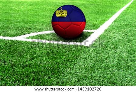 soccer ball on a green field, flag of Liechtenstein #1439102720