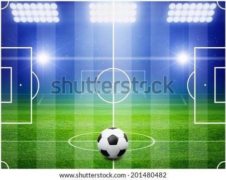 Soccer ball on field, arena in night illuminated bright spotlights, soccer goal, green field, soccer field layout, soccer field top view