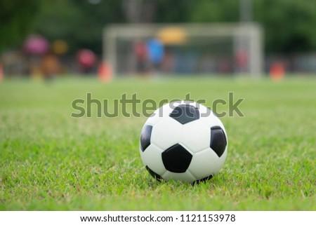 Soccer ball on football field. #1121153978