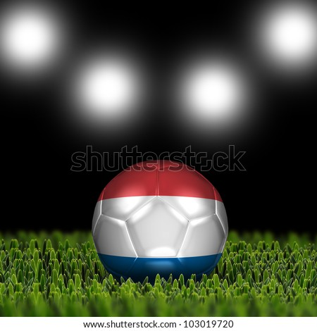 Soccer ball on grass against black and spotlight background. Country Netherlands