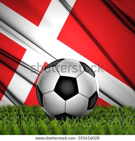 Soccer ball on grass against National Flag. Country Denmark