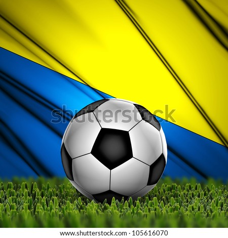 Soccer ball on grass against National Flag. Country Ukraine
